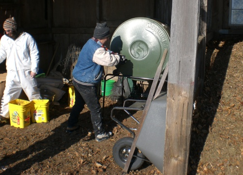 Resident Alex turns compost at Camphill Soltane.