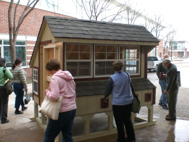PASA participants check out a mansion of a chicken coop.