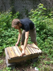 Micah's rustic top bar hive.